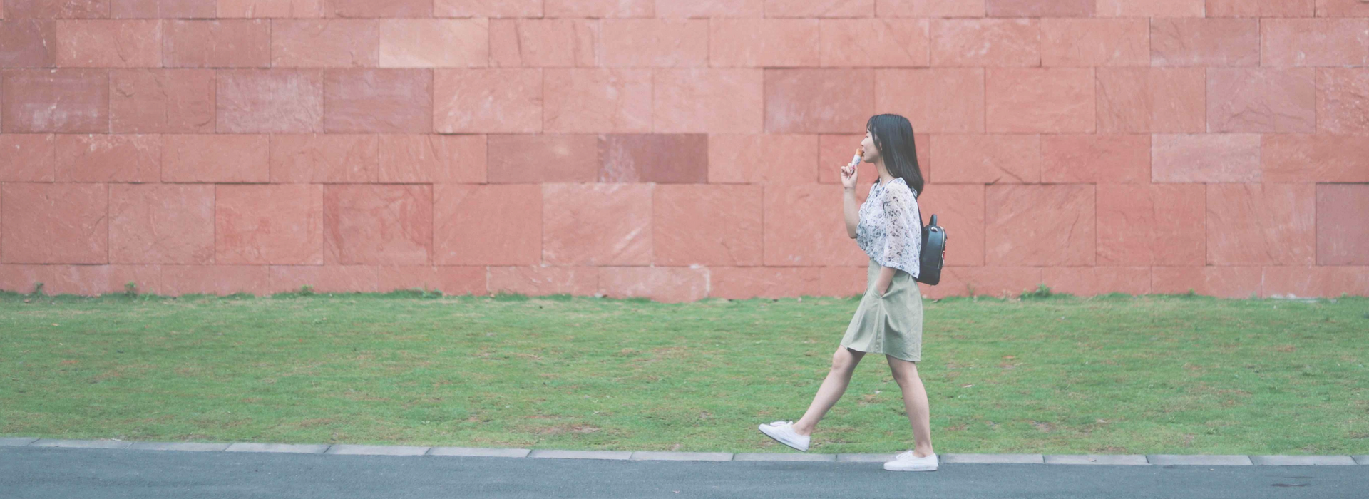 chinese-girl-walking-red-wall